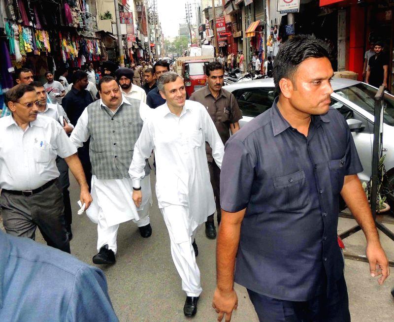 Jammu and Kashmir Chief Minister Omar Abdullah visiting Raghunath Bazar  in Jammu on AUg. 9, 2014.