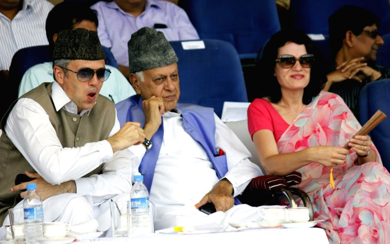 Jammu and Kashmir Chief Minister Omar Abdullah and National Conference (NC) chief Dr. Farooq Abdullah during 68th Independence Day celebrations at Bakshi Stadium in Srinagar on Aug 15, 2014.