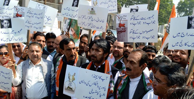 Jammu and Kashmir Congress chief G.A.Mir leads a demonstration to press for their demands in Srinagar on May 8, 2017.