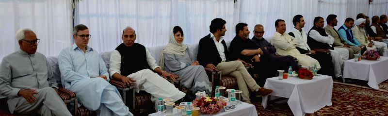 Jammu and Kashmir Governor N.N.Vohra, Jammu and Kashmir Chief Minister Mehbooba Mufti and Union Home Minister Rajnath Singh with National Conference Vice President Omar Abdullah and Deputy ... - Mehbooba Mufti, Rajnath Singh and Kavinder Gupta