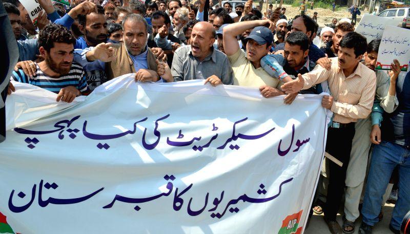 Jammu and Kashmir legislator Engineer Rashid leads a demonstration near civil secretariat in Srinagar on May 8, 2017.