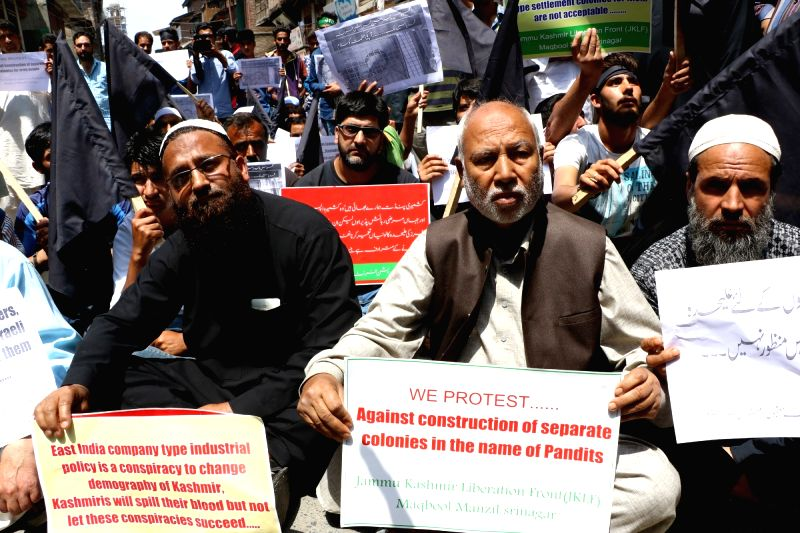Jammu and Kashmir Liberation Front (JKLF) activists stage a demonstration against proposed Sainik and Pandit colonies in Srinagar, on June 3, 2016, 2016.