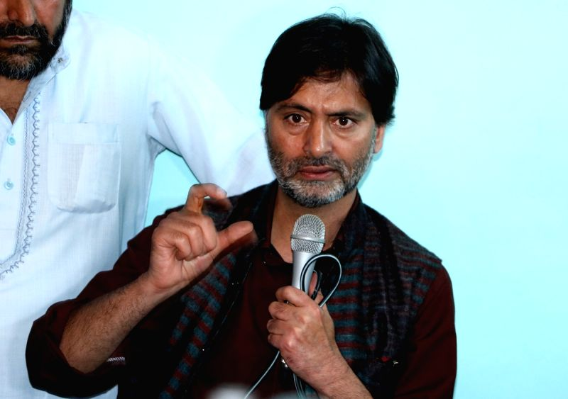 Jammu and Kashmir Liberation Front (JKLF) chief Muhammad Yasin Malik addresses a press conference in Srinagar on May 19, 2017. - Malik