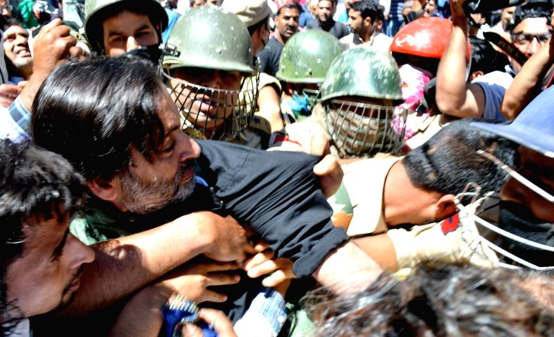 Jammu and Kashmir Liberation Front (JKLF) chief Yasin Malik being taken away by police in Srinagar on June 9, 2017. - Malik
