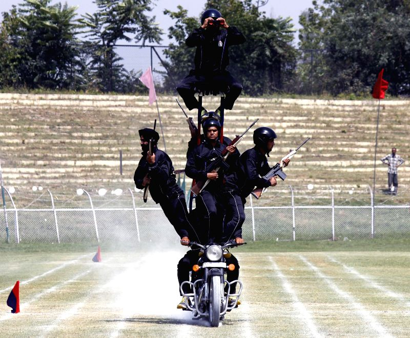 Jammu and Kashmir Policemen display their skills during 68th Independence Day celebrations at Bakshi Stadium in Srinagar on Aug 15, 2014.