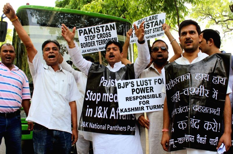 Jammu and Kashmir's National Panthers Party (NPP) stage a demonstration outside the Pakistan High Commission demanding to declare Pakistan a terror state, in New Delhi on May 13, 2017.