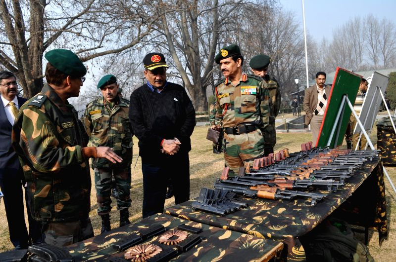 Jammu and Kashmir:  Union Defence Minister Manohar Parrikar inspects the weapons and ammunition seized by the army during its various operations against the militants at the Chinar Corps camp in ...