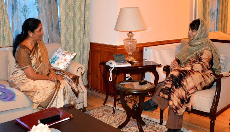 Jammu and Kashmir: Union Defence Minister Nirmala Sitharaman meets Jammu and Kashmir Chief Minister Mehbooba Mufti on Sept 29, 2017. Also seen Chief of Army Staff General Bipin Rawat. - Nirmala Sitharaman and Mehbooba Mufti