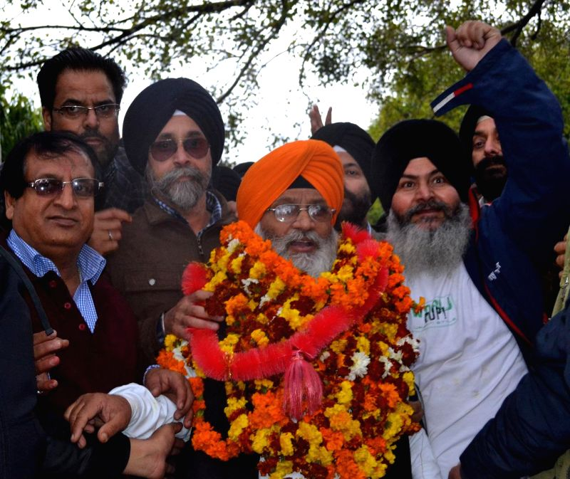 BJP leader Charanjeet Singh after winning in the Jammu and Kashmir Legislative Council Elections in Jammu on March 2, 2015. - Charanjeet Singh