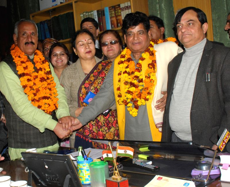 BJP leader Shamsher Singh Manhas and Chander Mohan Sharma during filing of nomination papers for the Rajya Sabha elections at Civil Secretariat in Jammu on Jan. 28, 2015. - Shamsher Singh Manhas and Chander Mohan Sharma