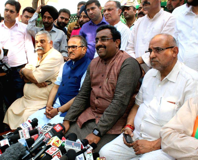 :Jammu: BJP national General Secretary Ram Madhav along with Jammu and Kashmir Deputy Chief Minister Nirmal Kumar Singh, talks to the press in Jammu on April 14, 2018. Ram Madhav told reporters at ...