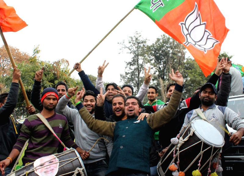 BJP workers celebrate party's performance in Jammu and Kashmir Assembly polls in Jammu, on Dec 23, 2014.