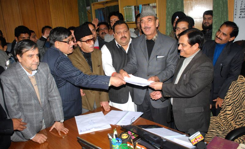Congress leader Ghulam Nabi Azad with National Conference party leaders filiing nomination papers for the Rajya Sabha election at Civil Secretariat in Jammu on Jan. 28, 2015.