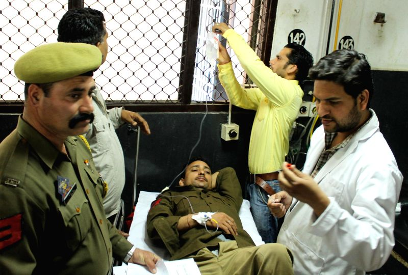 Deputy Superintendent of Police, Diwakar Singh, who sustained a bullet injury during an encounter with the militants being treated at Government Medical College and Hospital in Jammu on March ... - Diwakar Singh