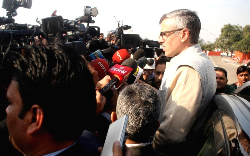 Jammu and Kashmir Chief Minister Omar Abdullah talks to press after tendering his resignation to Jammu and Kashmir Governor N.N. Vohra in Jammu on Dec 24, 2014.