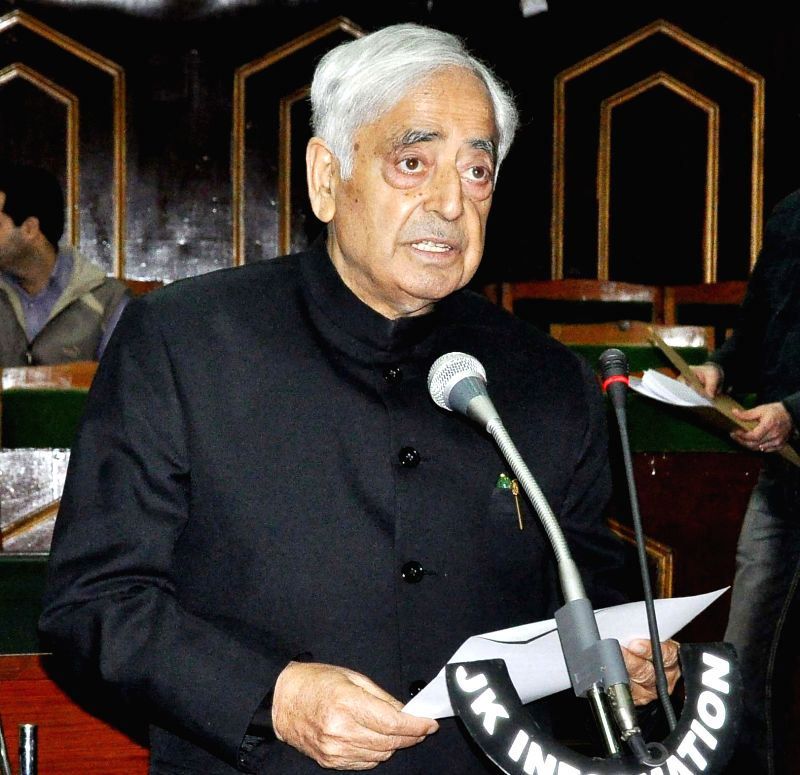 Jammu and Kashmir Chief Minister takes oath as a member of the legislative assembly in Jammu on March 17, 2015. The oath was administers by Muhammad Shafi the Protem speaker of the house.