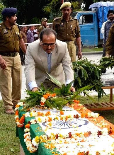Jammu and Kashmir Deputy Chief Minister Dr Nirmal Singh lays wreath at the coffin of Constable Parshotam Lal of Jammu and Kashmir Police in Kathua on March 20, 2015.Two policemen were killed ... - Nirmal Singh