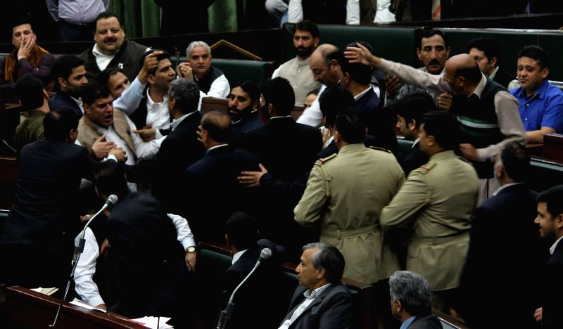 Jammu and Kashmir legislators get engaged in war of words in the state assembly in Jammu on March 20, 2015.