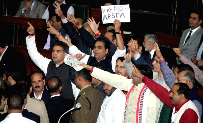 Jammu and Kashmir legislators stage a demonstration against Armed Forces Special Powers Act (AFSPA) in the state assembly in Jammu on April 7, 2015.