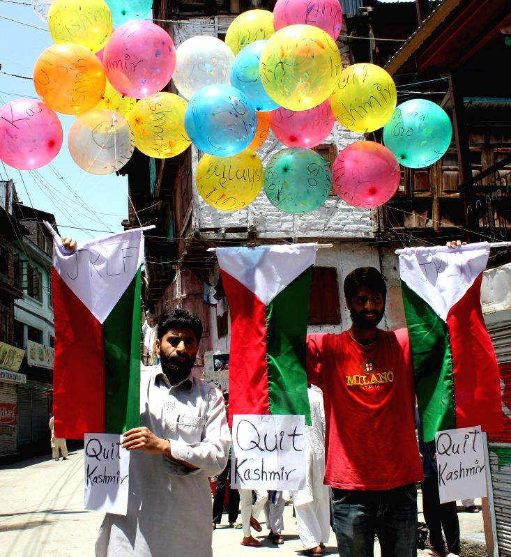 Jammu Kashmir Liberation Front (JKLF) activists release bunches of balloons tagged with the message `Quit Kashmir` during a day's shut down called to protest against Prime Minister Narendra Modi's ... - Narendra Modi