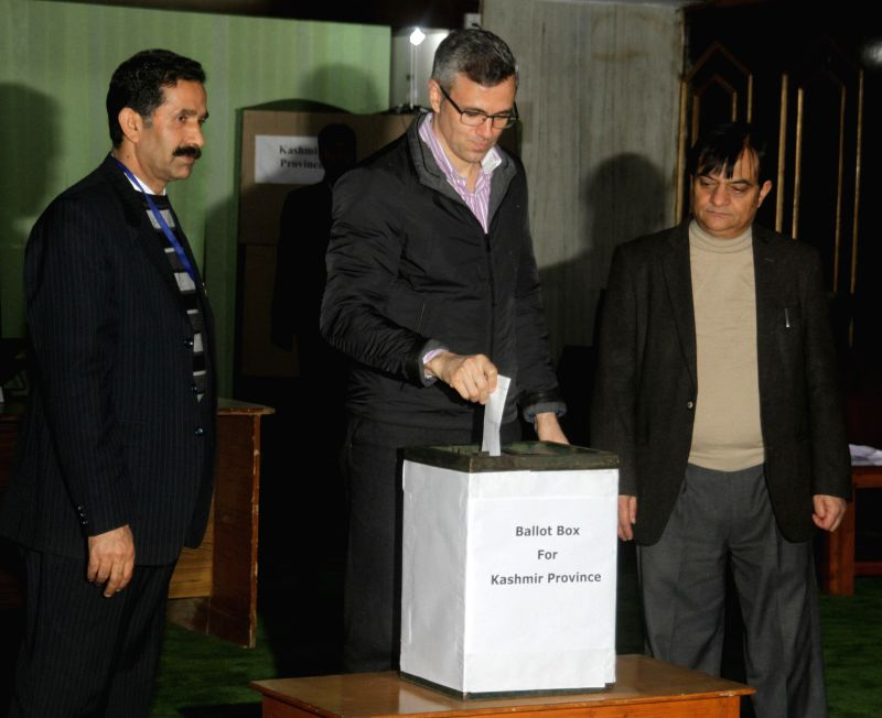National Conference leader Omar Abdullah casts his vote during the legislative council election at Jammu and Kashmir Legislative Assembly in Jammu on March 2, 2015.
