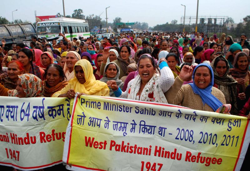 Pakistani refugees stage a demonstration in Jammu on Feb 24, 2015.