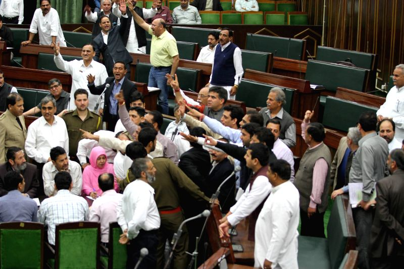 "Pandemonium over a National Conference legislator allegedly calling the speaker a ""Hindu fundamentalist"", mars Jammu and Kashmir legislative assembly proceedings in Jammu on March ..."