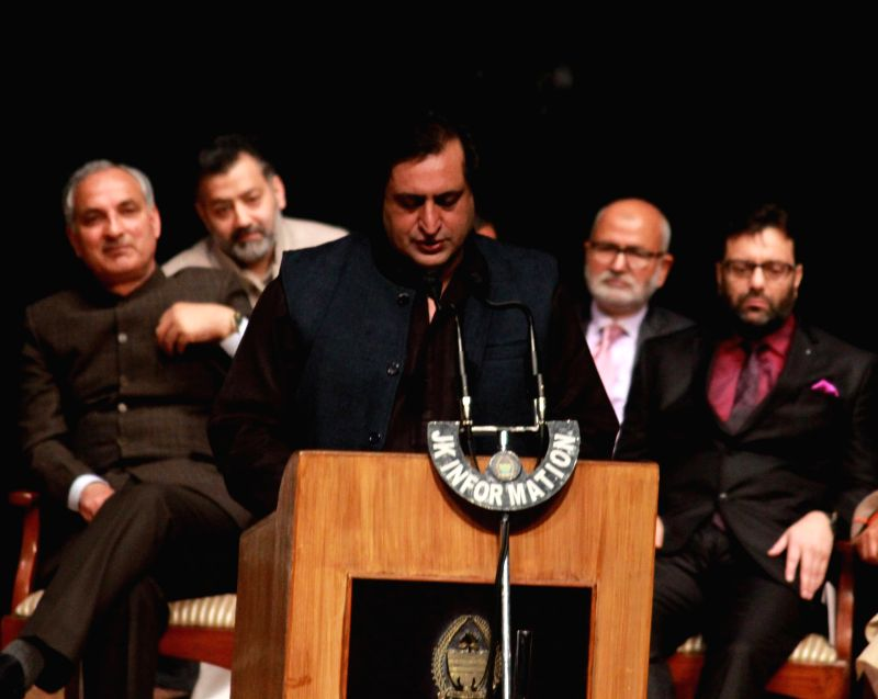 Peoples Conference president Sajjad Lone takes oath as a Jammu and Kashmir cabinet minister during a swearing-in ceremony organised at Jammu University on March 1, 2015.