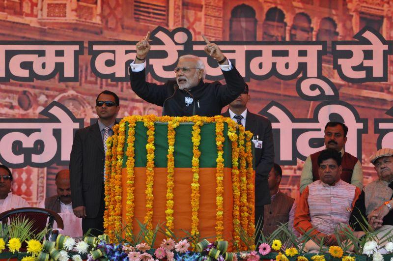 Prime Minister Narendra Modi during an election campaign at Maulana Azad Stadium in Jammu on Dec 16, 2014. - Narendra Modi