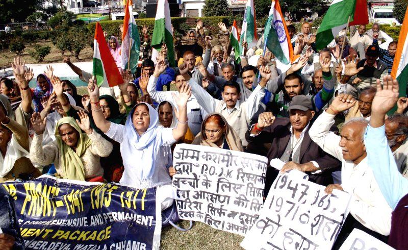 Refugees from Pakistan occupied Kashmir (POK) stage a demonstration in Jammu on Nov 24, 2014.