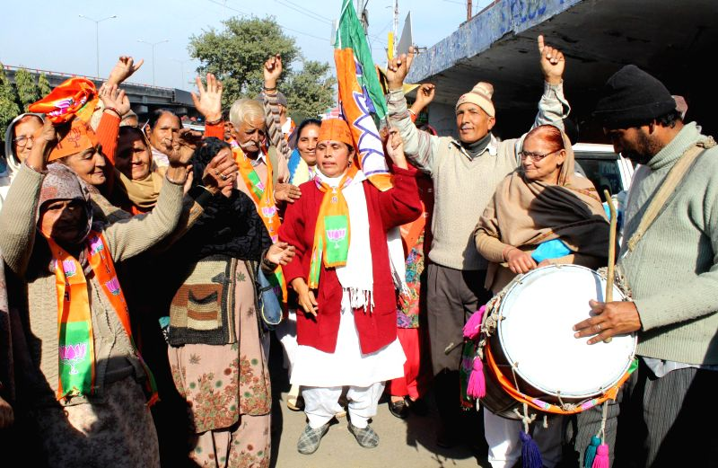 Refugees from Pakistan occupied Kashmir (PoK) celebrate BJP's performance in the recently concluded Jammu and Kashmir assembly polls in Jammu on Dec 24, 2014.
