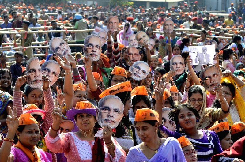 People gather at Prime Minister Narendra Modi`s rally in Jamshedpur, Jharkhand on Nov 29, 2014. - Narendra Modi