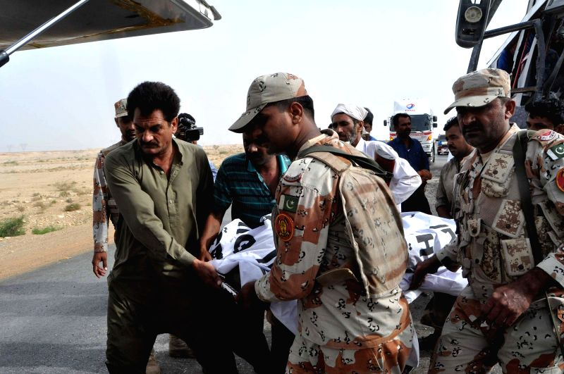 JAMSHORO (PAKISTAN), Aug. 2, 2016 Pakistani soldiers transfer the body of a victim of the road accident in Jamshoro, Pakistan, on Aug. 2, 2016. At least 12 people were killed and over 30 ...