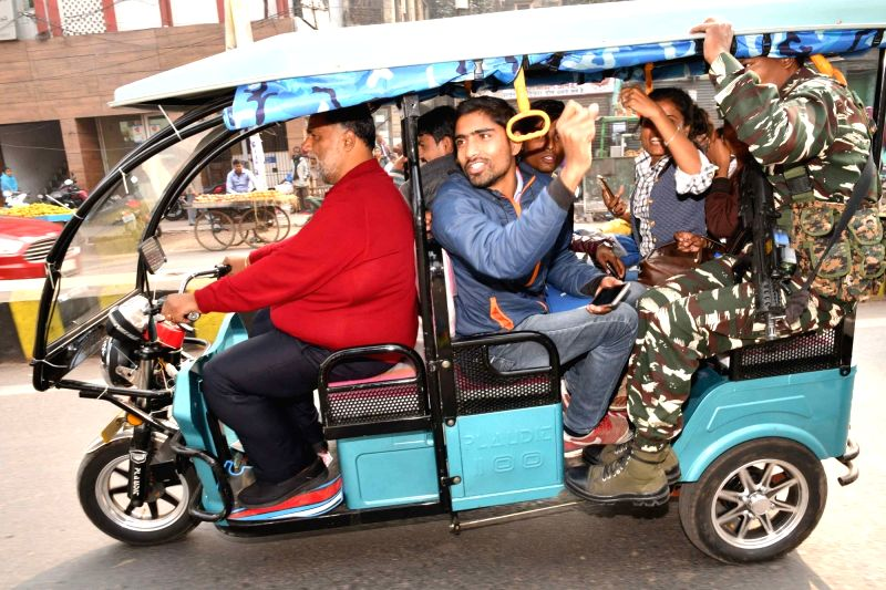 Jan Adhikar Party chief Rajesh Ranjan alias Pappu Yadav drives an e-rickshaw ahead of his appearing before a Patna court on Feb 1, 2018. - Pappu Yadav