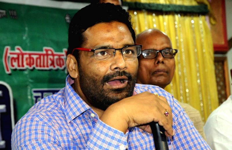 Jan Adhikar Party (JAP) leader Pappu Yadav addresses a press conference in Patna, on May 20, 2016. - Pappu Yadav