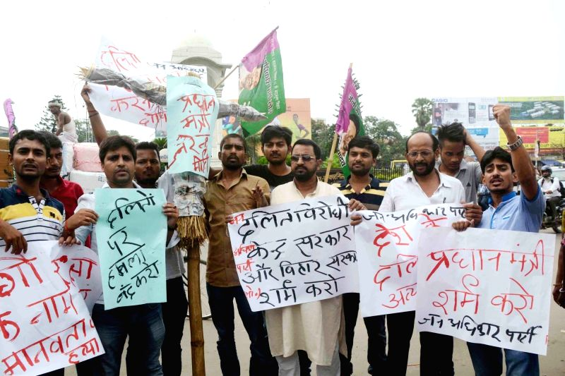 Jan Adhikar party workers stage a demonstration against Dalit Assault Case at Una; in Patna on July 21, 2016.