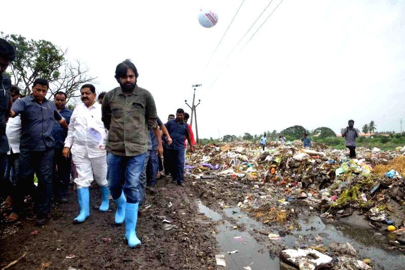 Jana Sena cheif Pawan Kalyan visits a dumping yard in Bhimavaram, Andhra Pradesh on Aug 11, 2018.