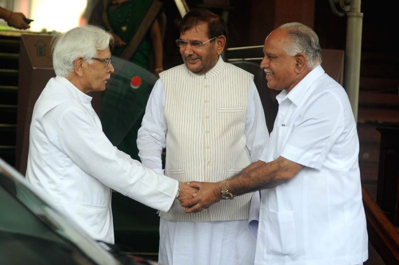 Janata Dal-United (JD-U) president Sharad Yadav, BJP leader and Shimoga MP BS Yeddyurappa and Congress leader Natwar Singh at the Parliament in New Delhi on Aug 6, 2014. - Sharad Yadav and Natwar Singh