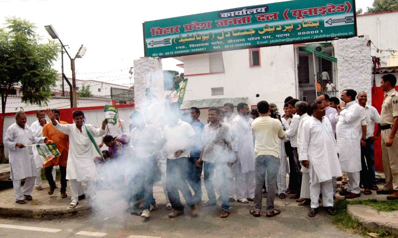Janata Dal (United) workers celebrate after the party won Jale and Parbatta Lok Sabha seats in recently concluded by-polls, in Patna on Aug 25, 2014.