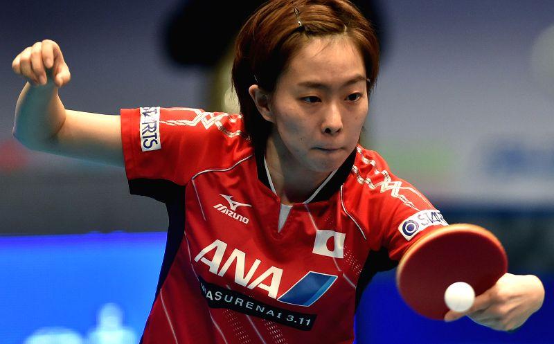 Japan's Ishikawa Kasumi returns a shot to China's Zhu Yuling during a women's single match of the 2015 ITTF World Tour Grand Finals in Odivelas, outskirts of Lisbon, ...