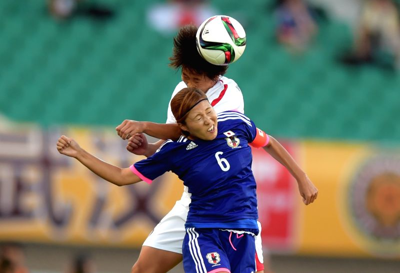 Japan's Kawamura Yuri (bottom) heads for the ball during the match against the Democratic People' s Republic of Korea (DPRK)  at the 2015 EAFF(East Asian Football ...