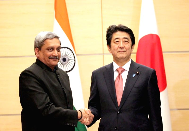 Union Defence Minister Manohar Parrikar calls on Prime Minister of Japan Shinzo Abe, in Japan on March 30, 2015.