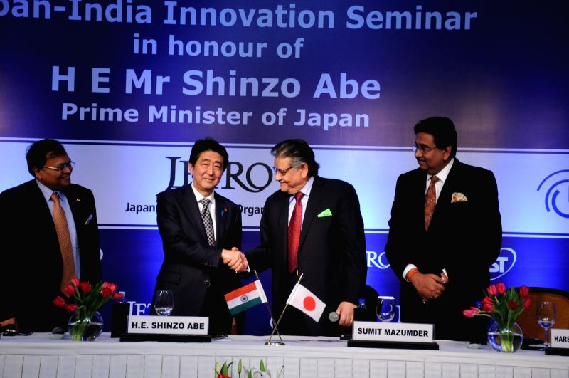 Japanese Prime Minister Shinzo Abe during a meeting with business leaders in New Delhi, on Dec 11, 2015. Also seen ASSOCHAM President Sunil Kanoria, CII President Sumit Mazumder and FICCI ... - Shinzo Abe