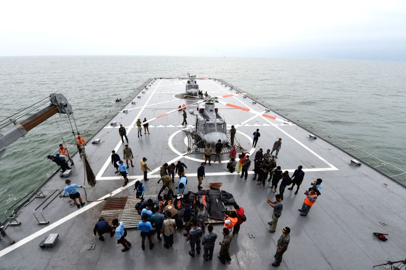 Indonesian navy personnel place bodies of victims of AirAsia flight QZ8501 on Indonesian navy vessel KRI Banda Aceh at Java Sea, in Indonesia, Jan. 3, 2015. ...