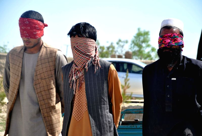 Militants stand handcuffed after being captured by Afghan security forces in Jawzjan province in northern of Afghanistan, April 21, 2014. Afghan security forces ...