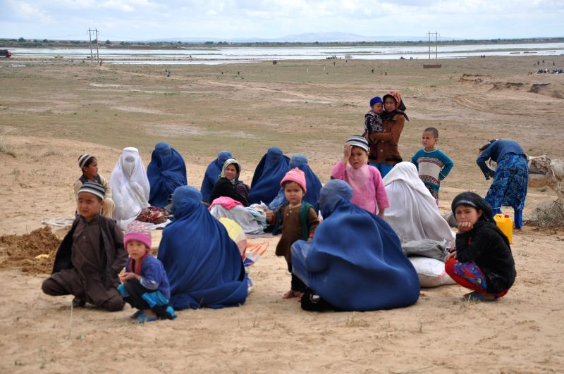 Women and children take a rest in Northern Province Jawzjan, Afghansitan, April 25, 2014. Heavy rains and flooding have claimed the lives of nearly 40 people in ...