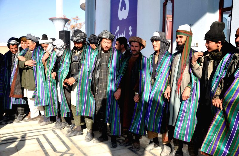 Taliban fighters attend a surrender ceremony in northern Afghan province of Jawzjan, Dec. 31, 2014.  About 200 rebels under Mawlawi Nematullah gave up fighting and .