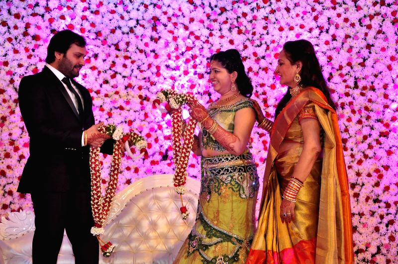 Jayaprada with couple during the wedding reception of actress Jayaprada`s son Siddharth with Pravallika Reddy in Hyderabad. - Pravallika Reddy
