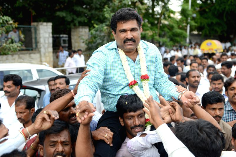 JD(S) candidate from Bangalore Teachers' constituency, Puttanna celebrates after winning the Legislative Council seat for the third consecutive time in Bangalore on June 24, 2014.