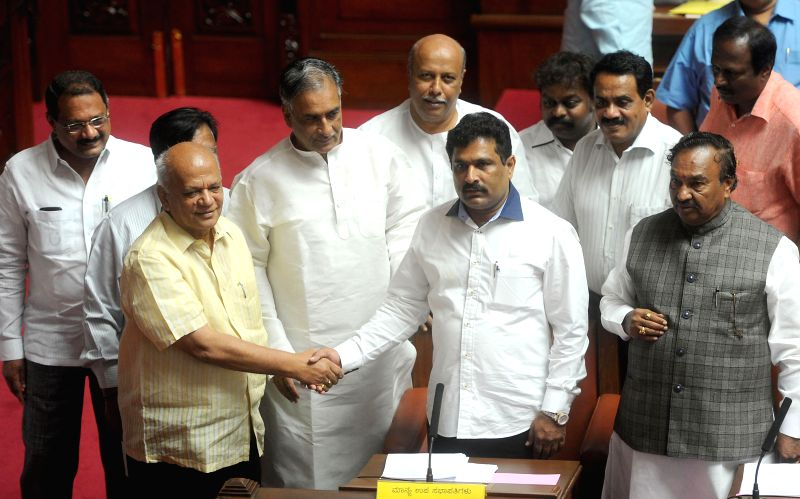 JD(S) legislator Puttanna being greeted by MLCs after he was elected as Vice Chairman of Karnataka Legislative Council in Bangalore on July 15, 2014.